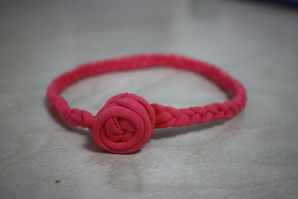 circle of braided jersey material and small jersey rosette attached
