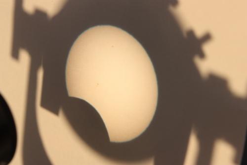 shadow of solar eclipse on manila folder