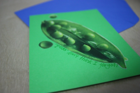 "cut-out image of peas glued to cardstock with message ""peas don't think i forgot"""
