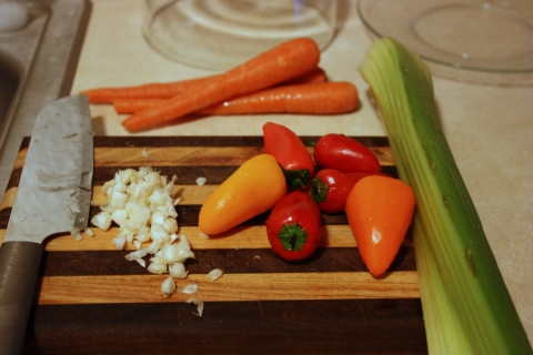 carrots, onions, pepper, celery on cutting board