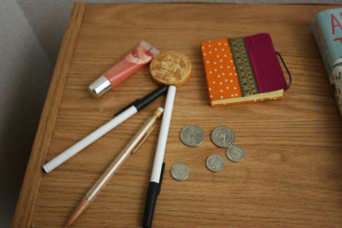 Bic pens, lip gloss, coins, notebook