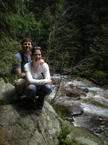 Lovey & M on a rock next to a river
