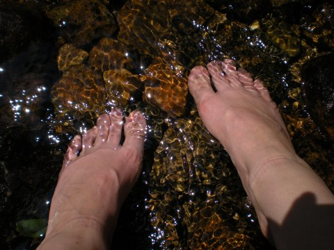 bare feet in the water