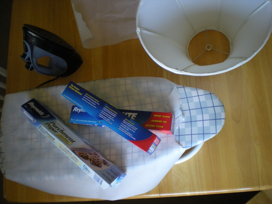 DIY capiz chandelier supplies: waxed paper, parchment paper, iron & ironing board, lampshade