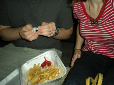 shoulders-and-legs: Lovey holding a styrofoam thing of fries