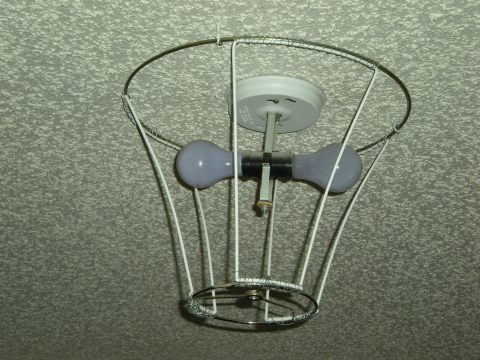 stripped lampshade hooked to ceiling, side view