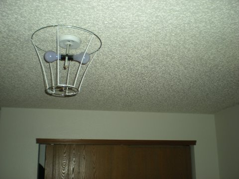 stripped lampshade hooked to ceiling, side view with context