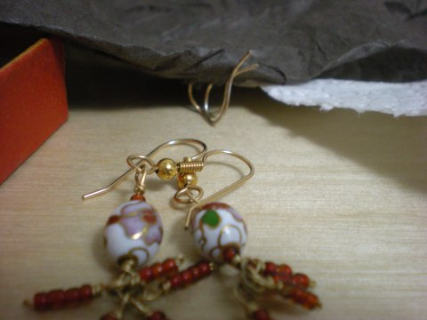 earrings (foreground) tissue paper pierced with fishhook earring backs (background)