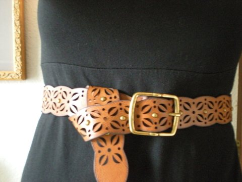punched faux leather belt
