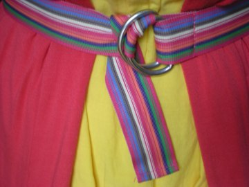 candy-striped belt over a yellow sundress