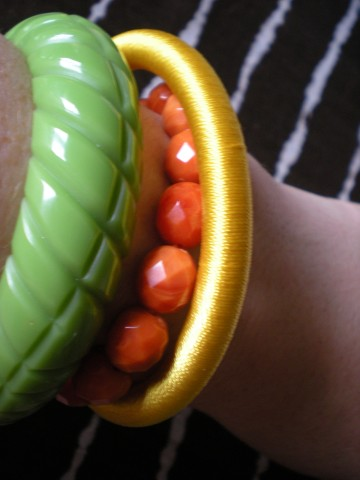 green, yellow, orange bracelets
