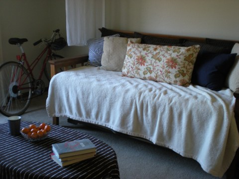 daybed with coffee table in foreground and bike in background