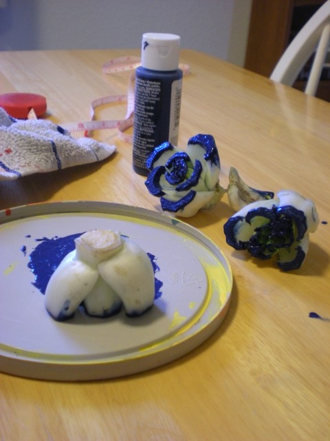 bok choy dunked in blue paint