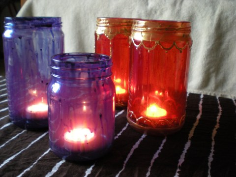 painted jars with lit candles inside
