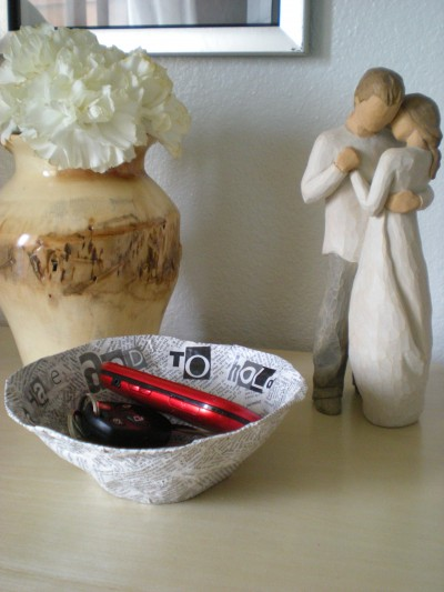 tableau with bowl holding keys and phone