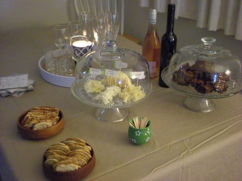 full spread--crackers, cheese, brownies, wine