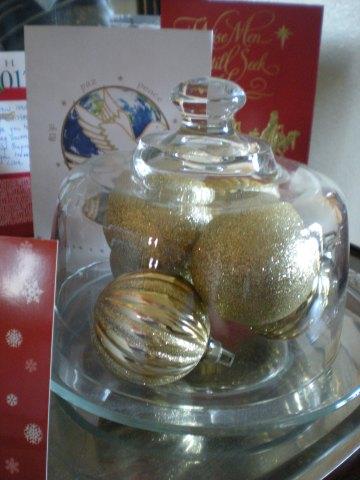 cloche with gold glitter ornaments