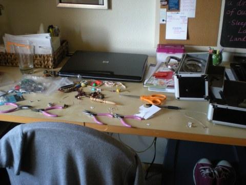 desk strewn with jewelry supplies