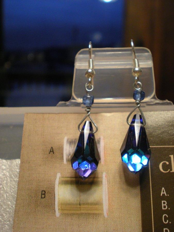 blue iridescent drop earrings match the night sky