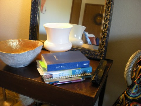 table with bowl, vase, books