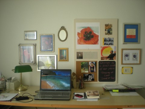 primary-color wall art over desk