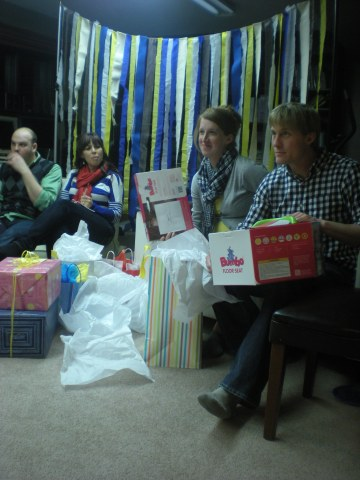 mommy and daddy opening gifts