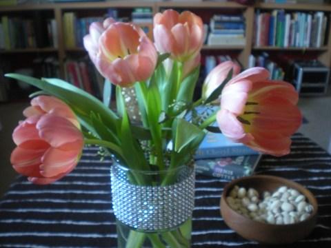 pale pink tulips in rhinestone-banded vase