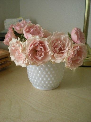 soft pink roses in hobnail milk glass vase