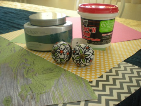 scrapbook paper, ceramic knobs, paint, and spackle