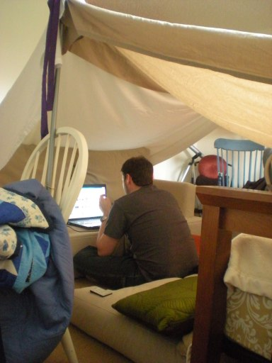 Lovey in the tent setting up the laptop