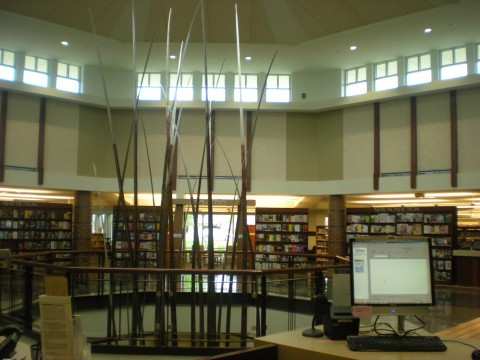"circulation desk with view of ""Enduring Prairie"" by Dale Merrill"